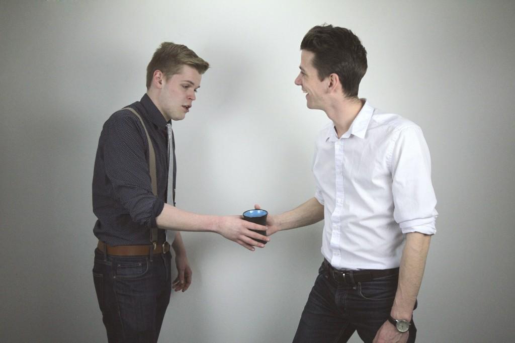 The awkward coffee grab:handshake-stratlab stock photos